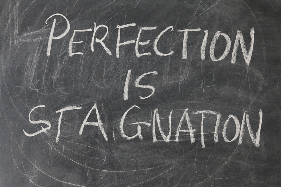 """Chalkboard that says """"Perfection is Stagnation"""""""