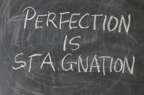 "Chalkboard that says ""Perfection is Stagnation"""
